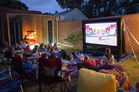 Watch a movie on our giant screen in the comfort of your own backyard.
